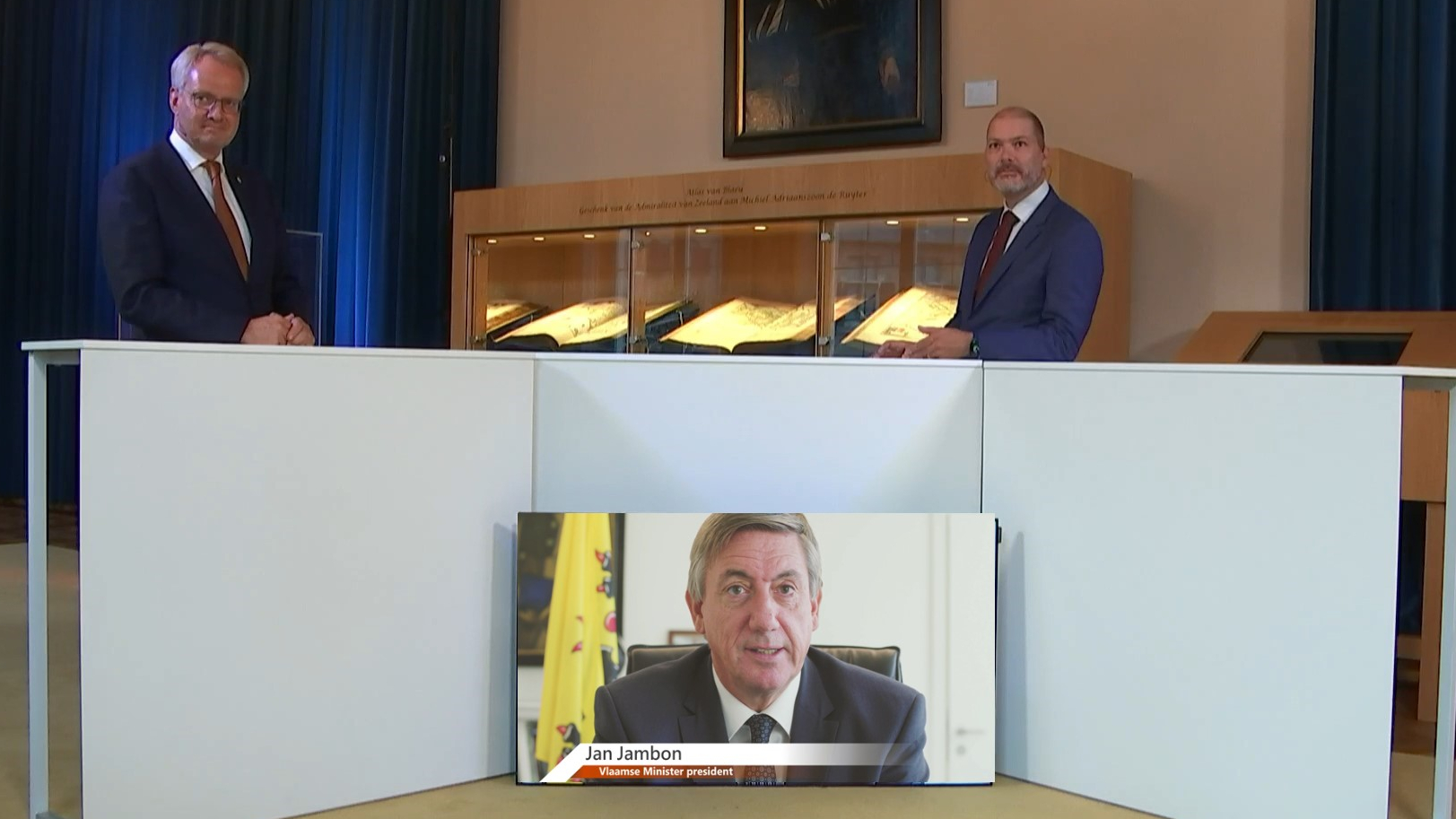 Commisser Han Polman and minister-president jambon  (screen ) at the Zeeuwse Oesterontmoeting Zeeland Oyster Meeting)